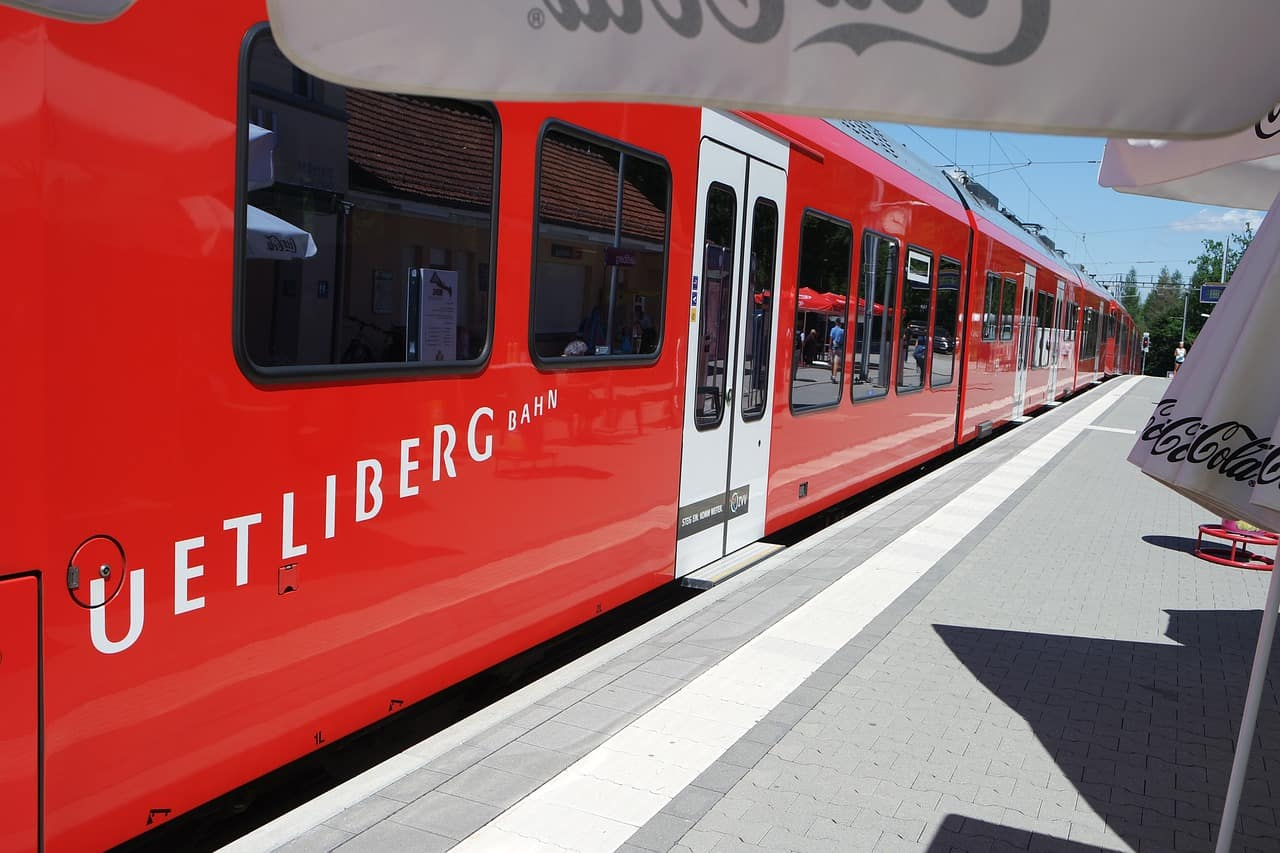 A passenger train stopped at a bus stop